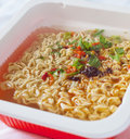 Chinese delicious noodle appetizer with seasoning and flavouring as a symbol of street food Royalty Free Stock Photo