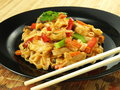 Chinese dish fried tagliatelle chicken breast and vegetables in Royalty Free Stock Image
