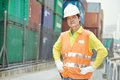 Chinese dock warehouse worker portrait of adult terminal cargo in front of container Stock Photo