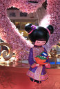 Chinese doll a huge is sitting at a shopping centre during new year period with beautiful decorations shot at mong kok Royalty Free Stock Photos