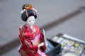 Chinese doll in kimono dress Royalty Free Stock Photos