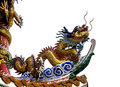 Chinese dragon on the temple s roof isolated flying white background Royalty Free Stock Image