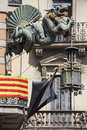 Chinese dragon and umbrella modernism architecture casa bruno cuadros with the catalan flag background in the ramblas barcelona Royalty Free Stock Image
