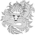 Chinese dragon in zentangle style for tatoo. Adult antistress coloring page. Black and white hand drawn doodle for coloring book Royalty Free Stock Photo