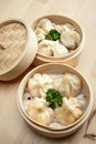 Chinese dumpling in a bamboo steamer box Royalty Free Stock Photo