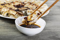 Chinese Dumplings with Chopsticks Royalty Free Stock Image