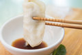 Chinese dumplings or jiaozi with chopstick on wooden board Royalty Free Stock Photography