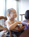 Chinese eating Yogurt happily Royalty Free Stock Photography
