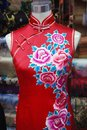 Chinese embroidery on silk cheongsam beautiful the traditional is an art of decorating textiles with needle and thread Stock Photos