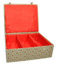 Chinese fabric covered box a with red lined interior isolated on a white background Stock Photo