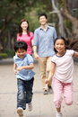 Chinese Family In Park With Children Royalty Free Stock Image