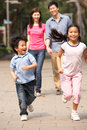 Chinese Family Walking Through Park Stock Photography