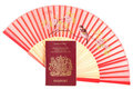 Chinese fan and British passport Stock Photography