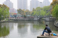 Chinese fisherman a man fishing at a park in pudong shanghai china Stock Image