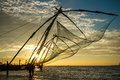 Chinese fishing net at sunrise in cochin fort kochi kerala india Stock Photos