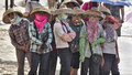 Chinese fishing women wearing traditional clothes looking forward to boats coming back from sea Stock Photo