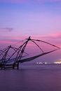 Chinese fishnets on sunset. Kochi, Kerala, India Stock Photos