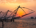 Chinese fishnets on sunset kochi kerala india silhouettes fort kochin Royalty Free Stock Photography