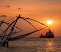 Chinese fishnets on sunset kochi kerala india silhouettes fort kochin Stock Photo