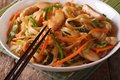 Chinese food chow mein with chicken and vegetables close up on a table horizontal Royalty Free Stock Photo