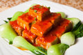 Chinese food delicious tofu and spinach on a white plate Stock Image