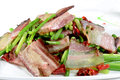 Chinese food fried bacon with vegetable in a white plate Stock Photo