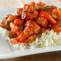 Chinese food - sweet and sour chicken on rice Royalty Free Stock Photo