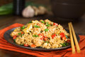 Chinese fried rice homemade with vegetables chicken and eggs served on a plate with chopsticks selective focus focus one Stock Photos