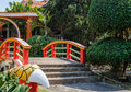 Chinese garden with red bridge Royalty Free Stock Photo