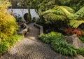 Chinese garden with stony bridge Royalty Free Stock Photo