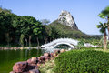 Chinese garden wiht arch bridge landscape stone and hill Royalty Free Stock Photos