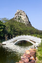 Chinese garden wiht arch bridge landscape stone and hill Stock Photography