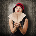 Chinese girl fanning herself with asian hand fan pretty traditional wooden Royalty Free Stock Photography