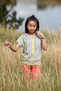 Chinese girl in field Stock Photos
