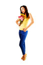 Chinese girl with flowers a very tall young woman standing for white background in blue pants and a yellow top holding a bunch of Royalty Free Stock Image