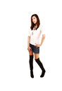 Chinese girl standing a very tall young woman for white background in black long boots and shorts Stock Photo