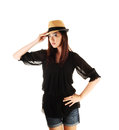 Chinese girl with straw hat a tall young woman standing for white background in a black blouse and jeans shorts a on her head Royalty Free Stock Images