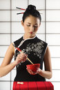 Chinese girl wuth food Stock Photography
