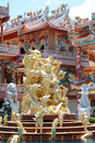 Chinese goddess statue with temple background thailand Royalty Free Stock Photos