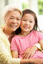 Chinese Grandmother And Granddaughter Relaxing Royalty Free Stock Image