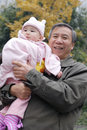 Chinese grandpa and baby Royalty Free Stock Photos