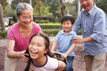 Chinese Grandparents Playing With Grandchildren Stock Image