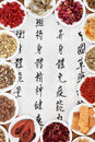 Chinese healing herbs traditional herbal medicine with mandarin script calligraphy on rice paper translation describes the Royalty Free Stock Image