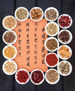 Chinese healing herbs traditional herbal medicine with mandarin script calligraphy translation describes the functions to increase Stock Photography