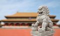 Chinese Imperial Lion Statue with Palace Forbidden city Royalty Free Stock Photo