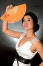 Chinese lady with fan asian female model wearing white dress young girl holding in hand smiling gently Stock Image