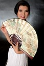Chinese lady with fan asian female model wearing white dress young girl holding in hand smiling gently Royalty Free Stock Images