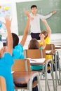 Chinese language classroom teacher in pointing students who raised hands during lesson Stock Image