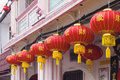 Chinese lanterns with wishing for fortune text new year red good hanging on historic peranakan buildings exterior Stock Photo