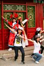 stock image of  Beijing China - June 7, 2018: Chinese tourists in national costumes are photographed at the pavilion in the Forbidden City.